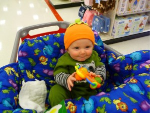 Check out my adorable pumpkin hat. My parents bought it for me.