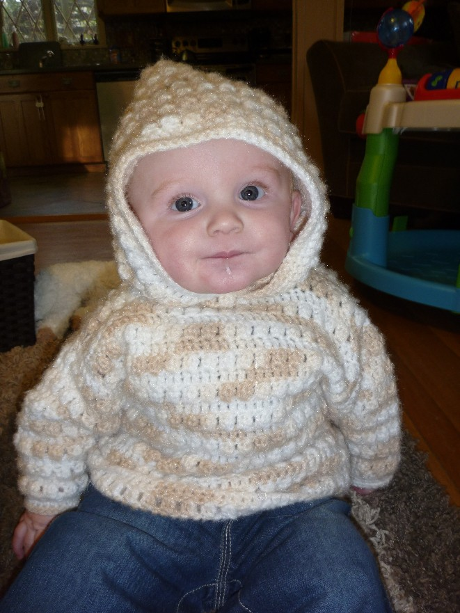 How cute is that sweater!? It has a zipper up the back and it fits him perfectly.