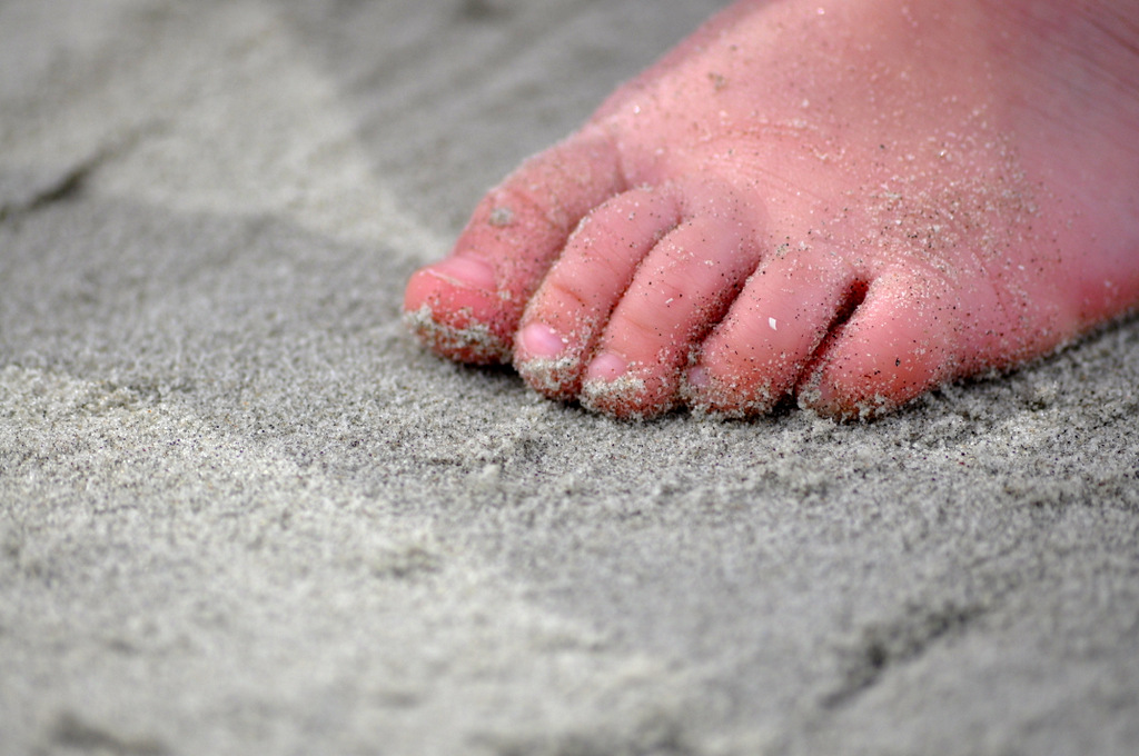 baby foot in the sand
